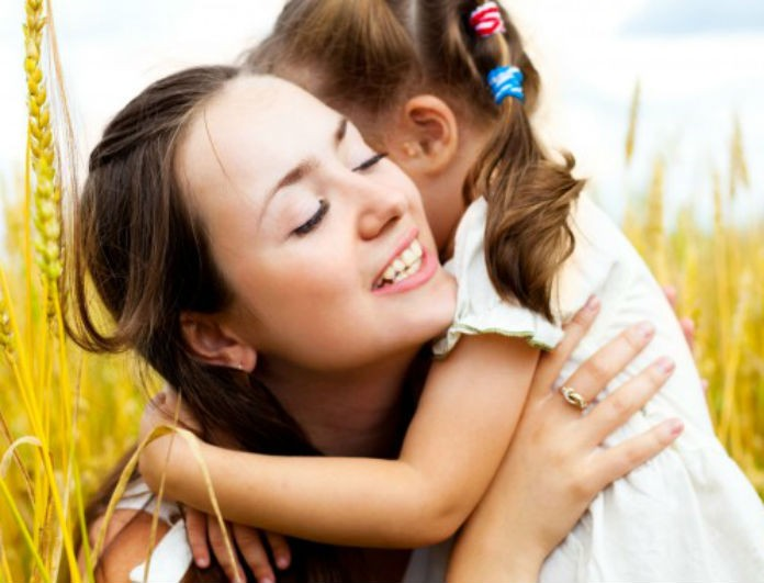 mother-hugs-kid