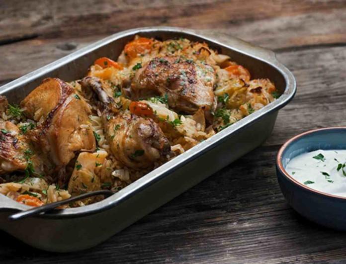 Ζουμερό κοτόπουλο στο φούρνο με ρύζι από την Αργυρώ Μπαρμπαρίγου